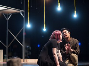 Bryan Luansing, right, goes over a scene from rock musical Spring Awakening with rehearsal stand-in Chelsea Laing.