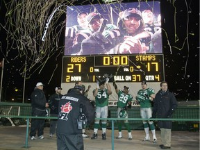Jeremy O'Day, 54, Eddie Davis, 29, and Mike McCullough, right, celebrate on Nov. 22, 2009 after the Saskatchewan Roughriders defeated the Calgary Stampeders 27-17 in the CFL's West Division final at Taylor Field.