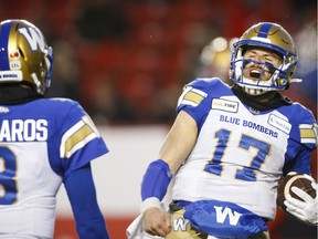 The Winnipeg Blue Bombers' Chris Streveler, right, celebrates his touchdown with fellow quarterback Zach Collaros during the fourth quarter of Sunday's CFL West Division semi-final against the host Calgary Stampeders. Winnipeg won 35-14 to earn a berth in Sunday's division final against the host Saskatchewan Roughriders.
