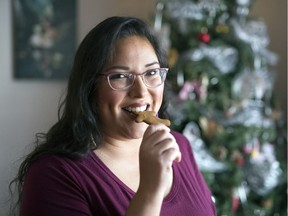 Jodi Robson was one of three finalists on the Great Canadian Baking Show. Here she enjoys a gingerbread man she made at her Regina home.