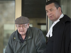 Father Robert Mackenzie, appearing for an appeal of an extradition order back to Scotland, where he faces sexual assault allegations leaves with his defence lawyer Al McIntyre in Regina on Wednesday, December 4, 2019.