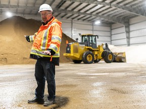 Operations Manager Kevin Faul leads a tour of the cold storage building at the Regina Bypass Operations and Maintenance facility.