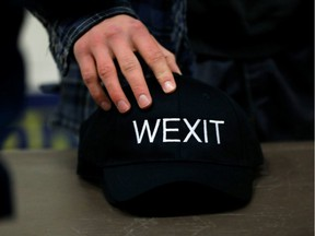 A supporter holds his Wexit hat while attending a rally for Wexit Alberta, a separatist group seeking federal political party status, in Calgary, Alberta, Canada November 16, 2019.