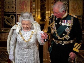 Britain's Queen Elizabeth and Charles, the Prince of Wales are seen during the State Opening of Parliament in the House of Lords at the Palace of Westminster in London, England, on Oct. 14, 2019.