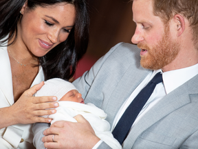 Prince Harry and Meghan, Duchess of Sussex hold their newborn son, Archie, at Windsor Castle, May 8, 2019. The family is spending Christmas in B.C.
