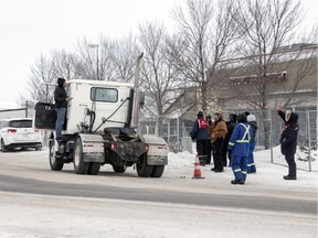 An upset truck drive voices his displeasure with locked out Unifor members that blocked off the Sherwood Co-op gas bar and Home Centre on Winnipeg Street and 9th Avenue North in Regina on Thursday, January 16, 2020.