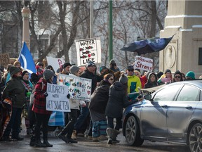"A motorist tries to drive through the line at the ""All Out For Wet'suwet'en"" protest that blocked the bridge on Albert Street in Regina, Saskatchewan on Feb. 8, 2020."