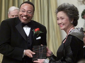 """Governor General Adrienne Clarkson presents the Governor General's Literary Award for poetry to George Elliott Clarke, of Toronto and originally of Windsor Nova Scotia, during a ceremony at Rideau Hall official residence of the Governor General in Ottawa, Wednesday, November 14, 2000. Emails show the University of Regina's dean of arts told George Elliott Clarke that he was sorry the acclaimed poet had been """"vilified"""" over his relationship with a killer of an Indigenous woman in the city. Clarke was also hopeful he would be invited back to the school someday."""