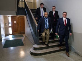 From right, Saskatchewan Premier Scott Moe, health minister Jim Reiter, Chief Medical Health Officer Dr. Saqib Shahab and Deputy Premier Gord Wyant walk down the steps of the west wing of the Saskatchewan Legislative building on their way to a media conference regarding the province's response to COVID-19 in Regina, Saskatchewan on Mar. 18, 2020.