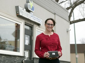 Sarah Kozusko,  pharmacy operator at Queen City Wellness Pharmacy, stands outside holding a naloxone kit in Regina on Friday, April 17, 2020.