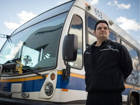 Kevin Lucier, president of ATU Local 588, stands next to a bus outside the City of Regina transit operations centre on Winnipeg Street in Regina, Saskatchewan on April 21, 2020.