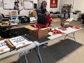 A Local 594 member gets ready for Wednesday¹s rally scheduled for 10:00 a.m. through Wascana Park and past the Legislative Building. Local 594 President Kevin Bittman says he anticipates some 400 members to show up.