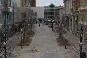 Scarth Street, as it intersects with 11th Avenue at the Cornwall Centre mall, is shown on a cold spring morning in Regina, Saskatchewan on April 1, 2020. This area, normally a hub of bustling downtown activity, sees much less foot traffic since the onset of the COVID-19 pandemic.