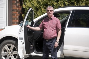 Ray Gartner, who has been volunteering with Meals on Wheels since 1995, stands by his vehicle on his driveway in Regina on Friday, May 15, 2020.