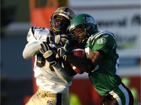 The Roughriders' Eddie Davis, right, intercepts a pass intended for the Winnipeg Blue Bombers' Milt Stegall in 2005.