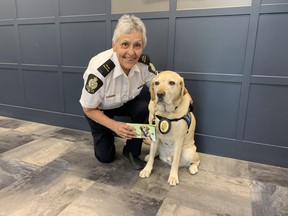 Donna Blondeau, Victim Services co-ordinator with the Moose Jaw Police Service, and her canine partner Police Service Dog Kane. Blondeau has written a book entitled Kane's Tale so children know Kane is there to help.