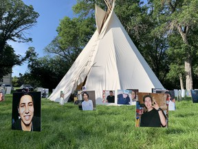 Faces of suicide victims surround a teepee on the lawns near the Legislative Building in Regina. The teepee was established by a group bringing awareness to the high rates of suicide in the province, especially amongst Indigenous people.
