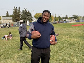 Saskatchewan Roughriders defensive end Charleston Hughes was all smiles during the Reggie City Freestyle Football Camp at the Access Communications Community Park on the weekend.
