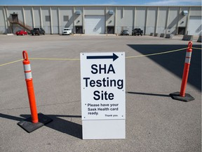 A sign marks the entry at the Saskatchewan Health Authority drive-thru COVID-19 testing facility in Regina on Sept. 8, 2020.