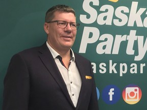 Saskatchewan Party Leader Scott Moe announced Sunday that Chris Guérette, right, would replace Daryl Cooper as the party's nominee for Saskatoon-Eastview. Cooper resigned Saturday after his history of sharing and promoting conspiracy theories online was brought to light.