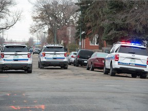 """olice vehicles are shown at the scene of a what police termed an """"operation"""" on the 1800 block of Halifax Street in Regina, Saskatchewan on Oct. 29, 2020. Roads around the area were blocked for part of the morning while the operation was ongoing."""