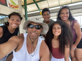 Former Saskatchewan Roughriders receiver Matt Dominguez (centre) and his family of Marcel (from left), Matthew, Victoria and wife Jennifer, shown here in warmer times, had to deal with a massive winter storm in Texas last week,