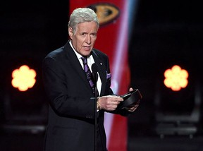 """FILE: """"Jeopardy!"""" host Alex Trebek presents the Hart Memorial Trophy during the 2019 NHL Awards at the Mandalay Bay Events Center on June 19, 2019 in Las Vegas, Nevada."""