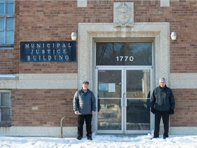 Retired Regina Police Service Staff Sgt. Bob Koroluk, left, and retired member Const. Marv Kereluke stand in front of the former Municipal Justice Building on Halifax Street in Regina, Saskatchewan on Jan. 8, 2020.