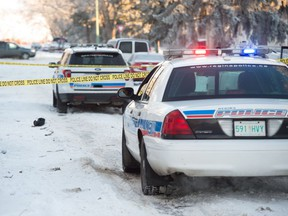 Police cruisers sit out front of a home on the 700 block of Athol Street in Regina, Saskatchewan on Jan. 16, 2021. After responding to a call that a woman had been shot, police found a woman at the scene with what they claim were serious injuries. The woman was transported to hospital.