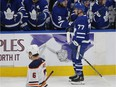 The Toronto Maple Leafs' Adam Brooks, 77, is congratulated by teammates Friday after scoring his first NHL goal.