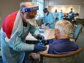 A Florida senior receives an injection of the Pfizer-BioNtech COVID-19 vaccine.