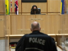 Regina Mayor Sandra Master can be seen listening while Regina Police Chief Evan Bray speaks to the Board of Police Commissioners during a meeting held at Regina City Hall in Regina, Saskatchewan on Feb. 23, 2021.