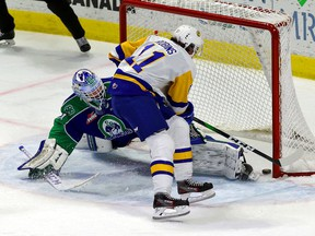 The Saskatoon Blades' Tristen Robins, 11, scores Wednesday's overtime winner on Swift Current Broncos goalie Isaac Poulter at the Brandt Centre.