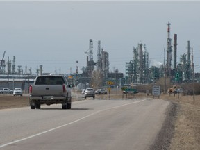 Conservatives finding carbon pricing plan hard sell in prairie heartland. Here Vehicles drive down McDonald Street toward the Co-op Refinery Complex in Regina, Saskatchewan on April 8, 2021.