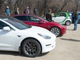 Electric vehicle owners and advocates gather to speak to MLAs regarding the new electric vehicle tax in front of the Saskatchewan Legislative Building in Regina, Saskatchewan on April 10, 2021.