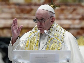 Pope Francis delivers his Urbi et Orbi blessing, after celebrating Easter Mass at St. Peter's Basilica at the Vatican on Sunday, April 4, 2021.