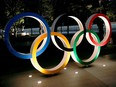 The Olympic rings are illuminated in front of the National Stadium in Tokyo on Jan. 22.