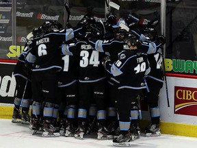 The Winnipeg Ice celebrates Tuesday's 3-2 overtime victory over the Saskatoon Blades at the Brandt Centre.