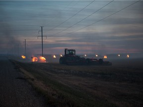 Bales burn in a field roughly 25 kilometres east of Moose Jaw along the Transcanada highway near Kalium Road in October, 2017. BRANDON HARDER files