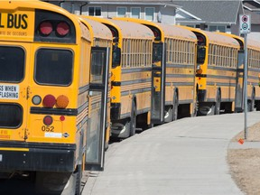 School buses are lined up at Ecole Wascana Plains School in Regina on May 3, 2021.