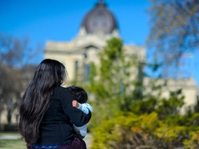 """The NDP raised the issue of Ms. """"Jo"""" Pereira and her son (pictured above) in the Saskatchewan legislature on May 6, 2021. Both contracted COVID-19 but encountered difficulty with health coverage. She is here on a student visa, while her child was born here. Photo by David Bruce."""