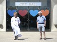 Barbara Keirnes-Young and Andre Nogue stand in front of City Hall in Regina, Saskatchewan on June 3, 2021. Both are volunteers with Age Friendly Regina, a group dedicated to advocacy for the elderly.