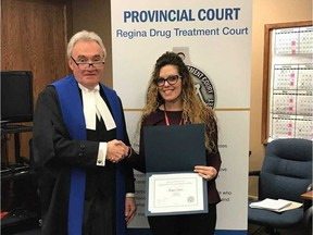 Meagan Jasper stands with Drug Treatment Court Judge Pat Reis upon completing the program in January 2019. Submitted photo.