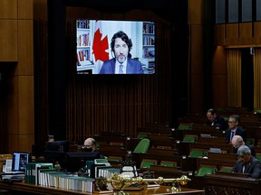Prime Minister Justin Trudeau is seen on a screen as he speaks during question period in the House of Commons on June 22, 2021.