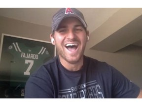 Saskatchewan Roughriders quarterback Cody Fajardo, shown wearing a Los Angeles Angels cap during Zoom call on Tuesday, excelled in baseball before opting to concentrate on football.