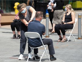 A man gets a vaccination at a pop-up COVID-19 vaccine clinic on Scarth Street in Regina, Saskatchewan on June 16, 2021.