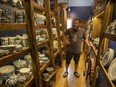 Jeffrey Taylor stands inside the retail space at his pottery studio in Duval.