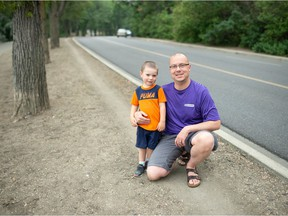 Shawn Weimer of Run Regina and his son Lucan Weimer are pictured on the side of Lakeshore Drive in Regina on August 3, 2021. Weimer is among those involved in helping the Provincial Capital Commission to run a pilot project that would see the street shut down from Legislative Drive to Old Broad Street to vehicle traffic on select days to provide more room for cyclists and runners.