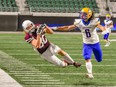 Rylan Sokul of the Regina Thunder makes a spectacular, 42-yard catch despite tight coverage from Jared Giddings of the Saskatoon Hilltops in Prairie Football Conference action Saturday at Mosaic Stadium. Sokul's big play set up the game-winning touchdown. Wanda Harron Photography.