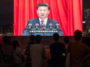 A screen shows Chinese President Xi Jinping speaking during a light show in Tamar Park in Hong Kong, China, on Thursday, July 1, 2021.
